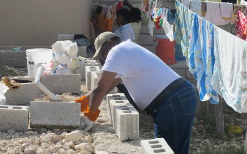 laying the cement blocks around the structure
